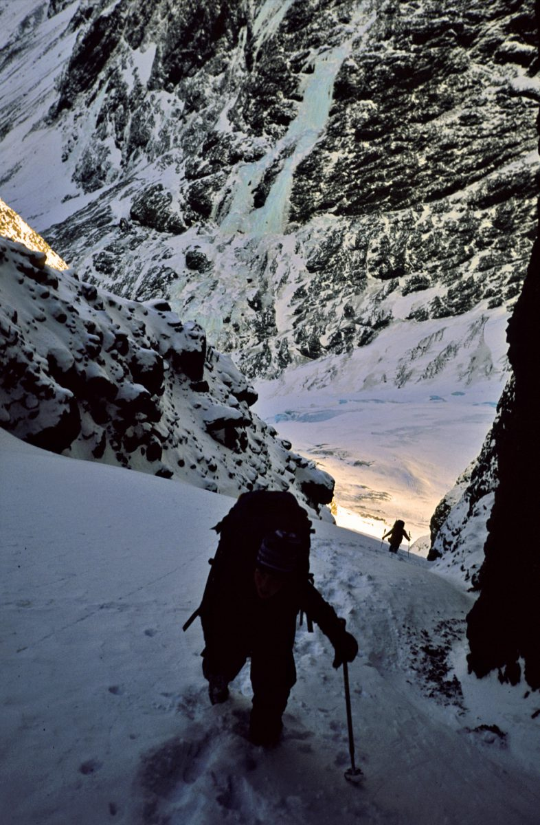 Kathy Zukor in the Bellicose / Benign Gully, March 2004. Note the Eklutna Glacier in the background which reached all the way to the base of Mitre Might. The glacier has retreated over a 1/4 mile since then and the gully has rapidly changed.